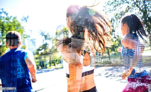 Fit people exercising and running in the city streets and public park