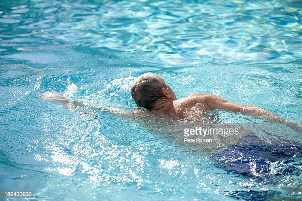 Fit retired man swimming in pool