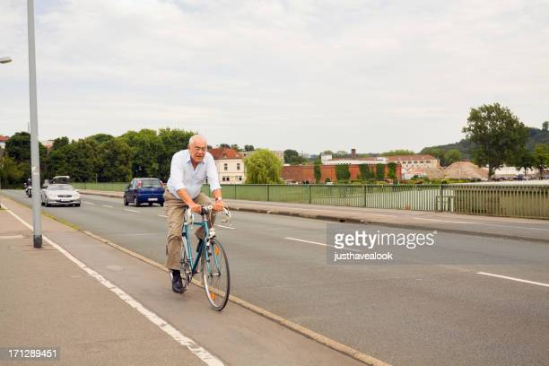 fit senior on bicycle - north rhine westphalia stock pictures, royalty-free photos & images