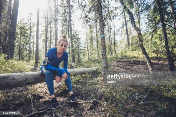 fit woman athlete resting outdoors. - resting stock pictures, royalty-free photos & images