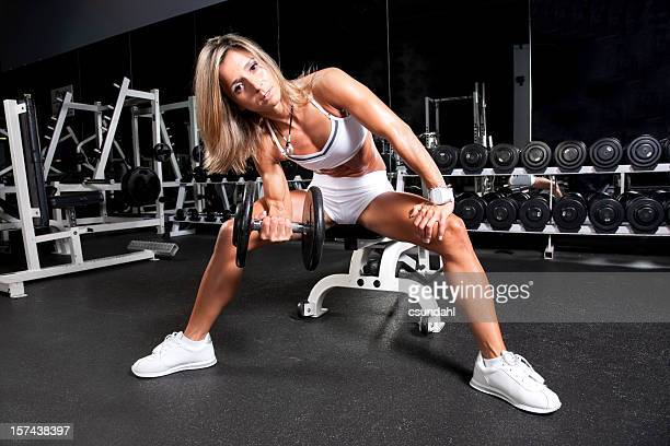 Fit woman excercising in the gym
