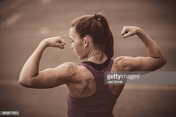 Fit Woman Flexing