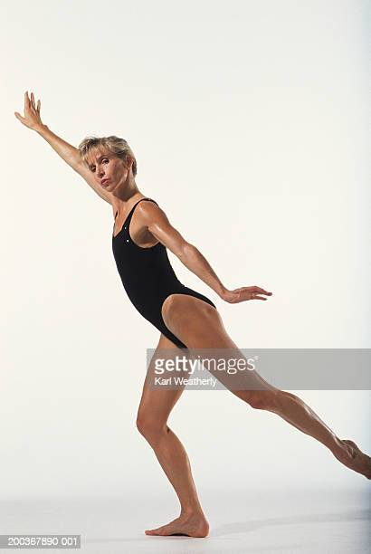 Fit woman in leotard in aerobic pose