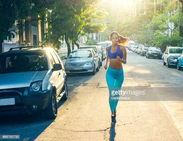 fit woman jogging in the city
