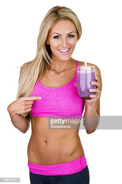 Fit woman pointing to a smoothie