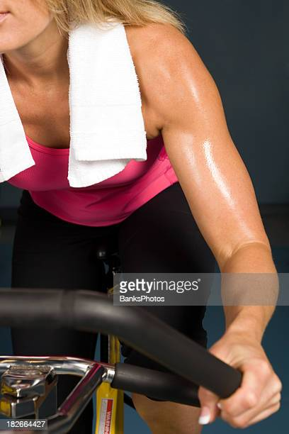 Fit Woman Riding an Exercise Bike