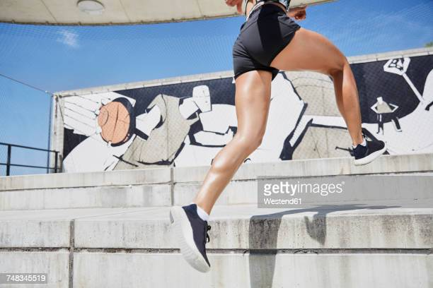 fit woman running outdoors - leap day stock pictures, royalty-free photos & images