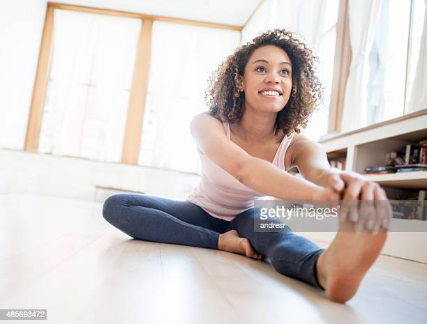 Fit woman stretching at home