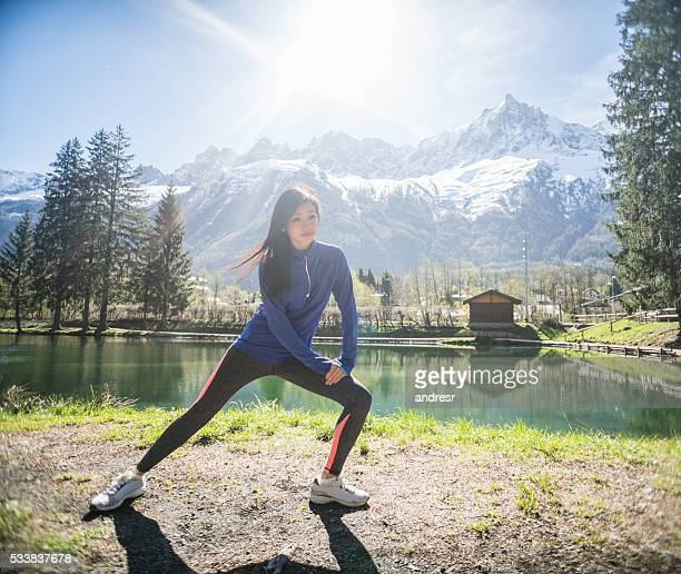 Fit woman stretching outdoors