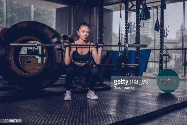 fit woman training hard - asian female bodybuilder stock photos and pictures