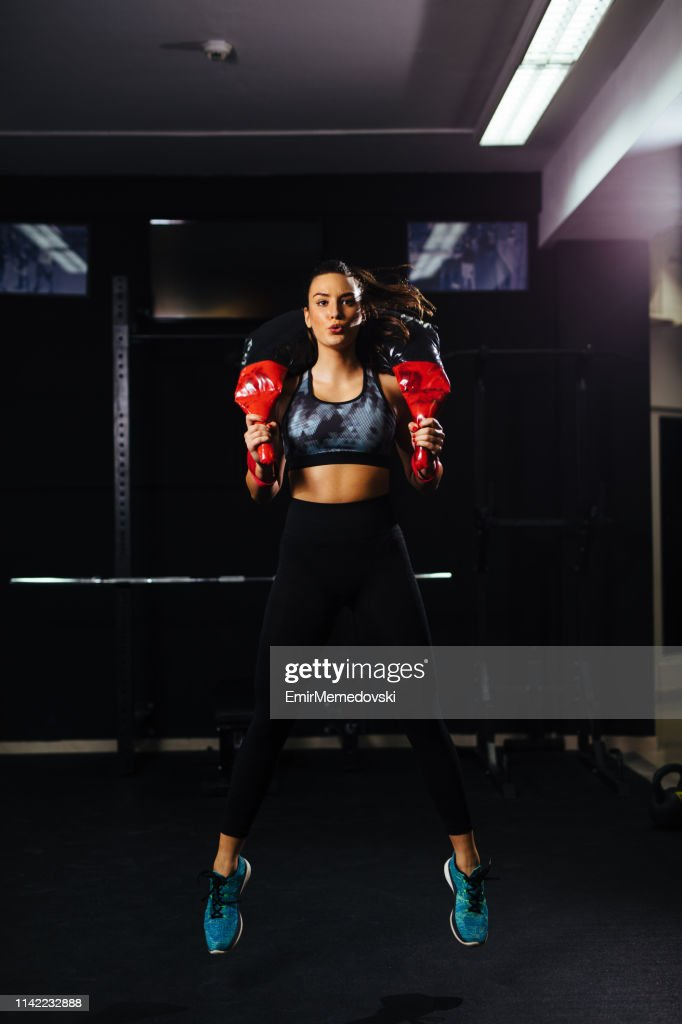 Fit woman training with weights at gym : Stock Photo