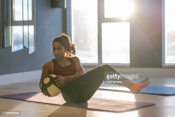 fit woman with a medicine ball - cardiovascular exercise stock pictures, royalty-free photos & images