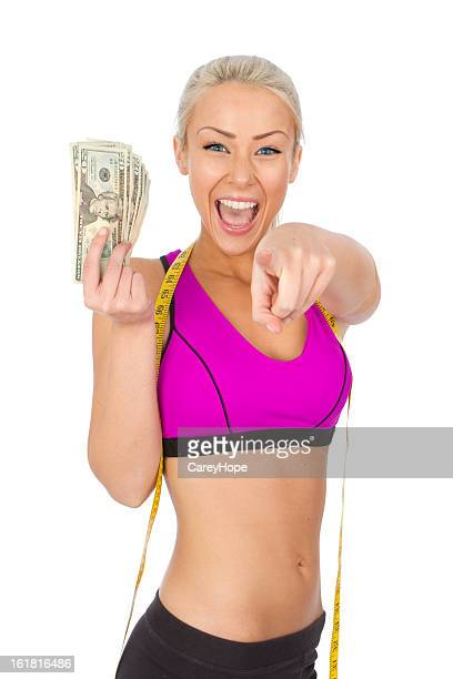 fit woman with cash