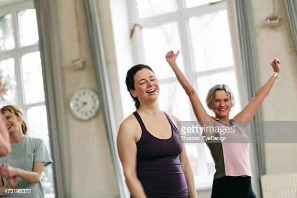 Fit women celebrating success in health club