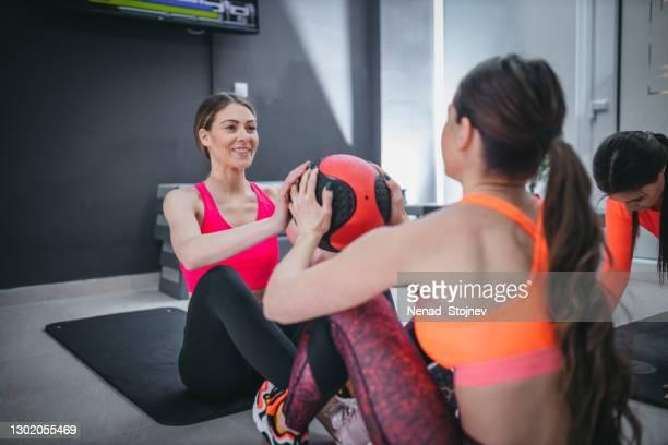 shot two sporty young women working