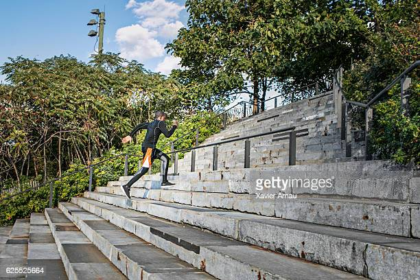 Fit young african man exercising on steps