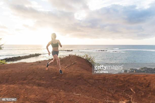 fit young eurasian woman runs along hawaii beach on hawaii beach - category:census-designated_places_in_honolulu_county,_hawaii stock pictures, royalty-free photos & images