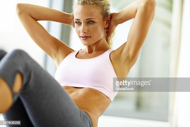 Fit young lady doing crunches
