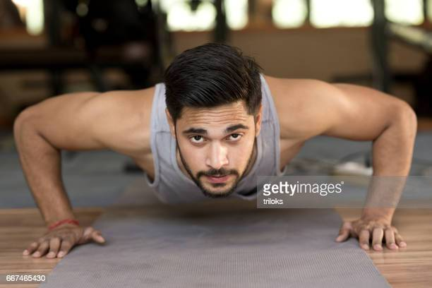 Fit young man doing push-ups