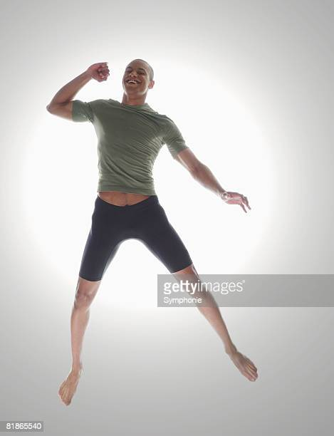 fit young man jumping for joy