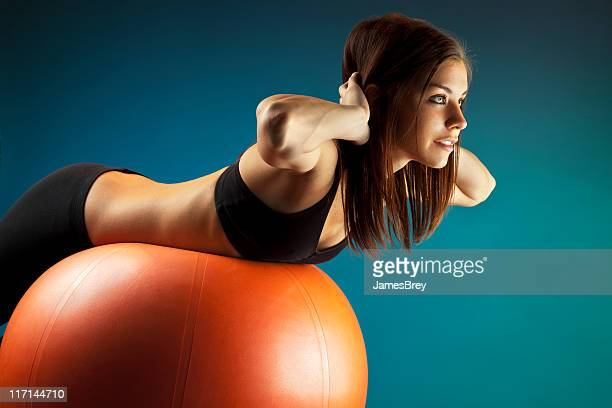 Fit Young Woman Training on Exercise Ball