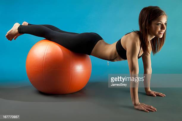 fit young woman training with exercise ball - skinny black woman stock photos and pictures