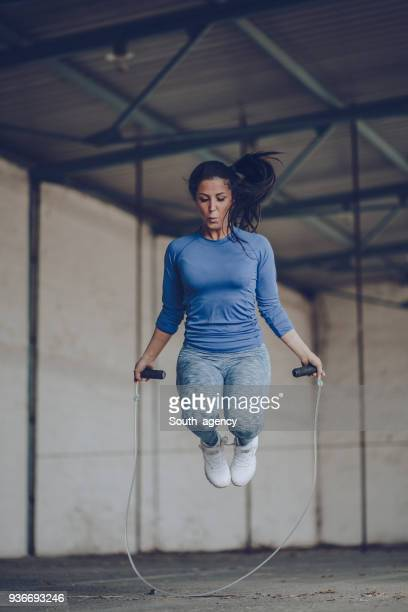 fit young woman with jump rope - skipping along stock pictures, royalty-free photos & images