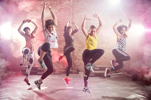 Fit young women dancing  and exercising 535496960