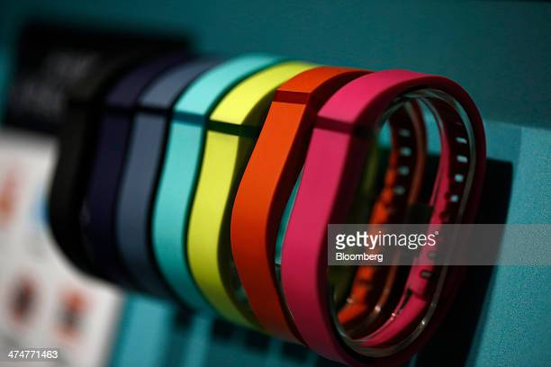 Fitbit Flex wearable electronic fitness devices sit on display at the Fitbit Inc. Pavilion on day two of the Mobile World Congress in Barcelona,...