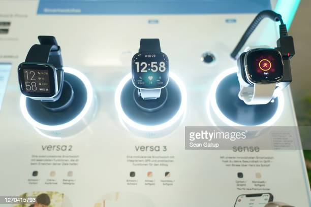 Fitbit health smartwatches lie on display at the Fitbit stand at the IFA 2020 Special Edition consumer electronics and appliances trade fair on the...