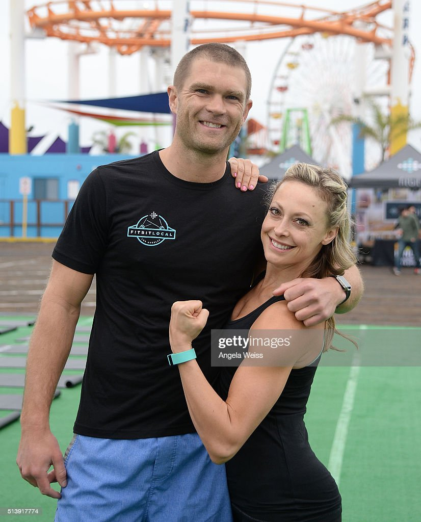 Fitbit Local Ambassadors Elise Joan (R) & Todd McCullough lead participants in a bootcamp and yoga workout at Santa Monica Pier. Fitbit Local Los Angeles launches with a free event on March 5, 2016 in Santa Monica, California.