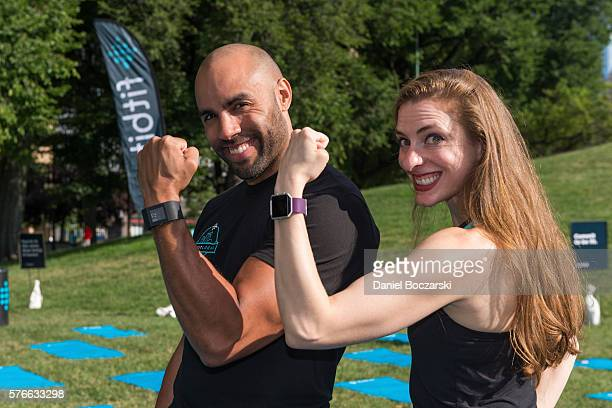 Fitbit Local Ambassadors Jeremy Walton and Jenny Finkel pose during the launch of Fitbit Local Free Community Workouts In Chicago at Grant Park on...