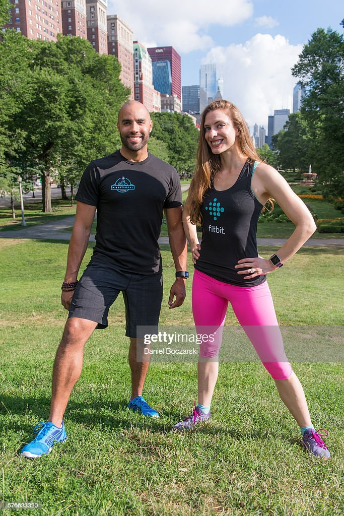 Fitbit Local Ambassadors Jeremy Walton and Jenny Finkel pose during the launch of Fitbit Local Free Community Workouts In Chicago at Grant Park on July 16, 2016 in Chicago, Illinois.