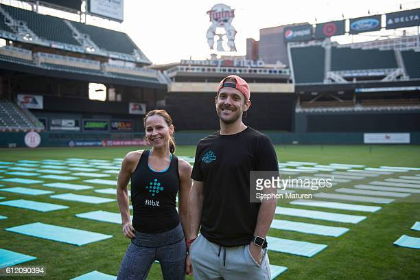 Fitbit Local Ambassadors Joy Himley and J.C. Lippold pose for a photo as Fitbit Local Minneapolis launches with a free event at Target Field on...
