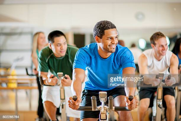 fitness class at the gym - spinning stock pictures, royalty-free photos & images