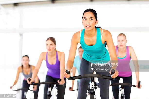 Fitness Class Looking Away While Spinning At Gym
