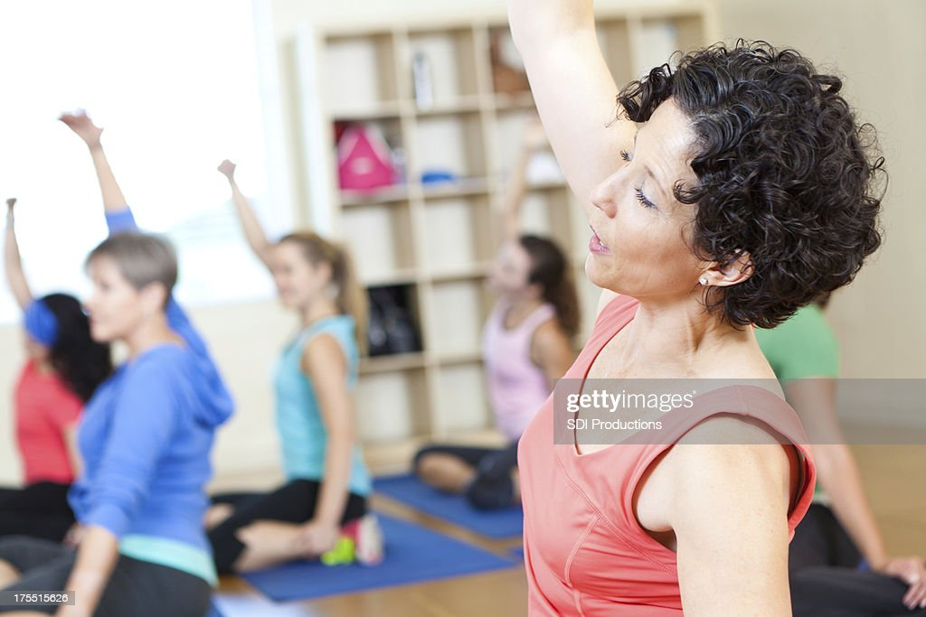 Fitness class of women doing stretching exercises : Stock Photo