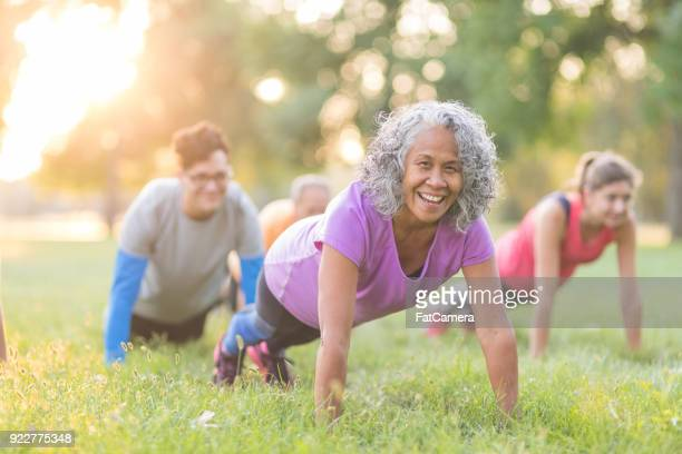 fitness class outside - active senior stock photos and pictures