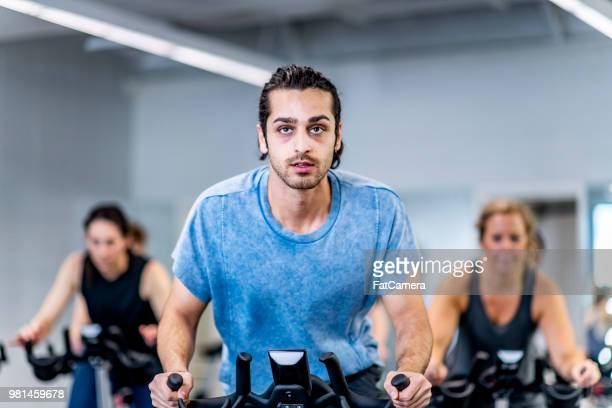 fitness class - exercise bike stock photos and pictures