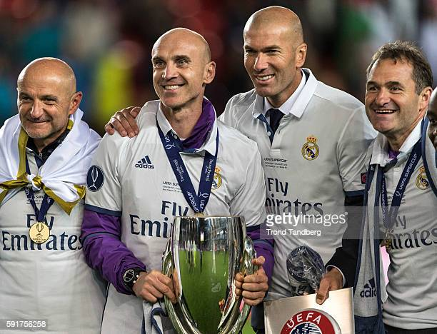 Fitness Coach Antonio Pintus Assistant Coach David Bettani Zinedine Zidane Keeper Coach Luis LLopis celebrate with the trophy after theUEFA Super Cup...