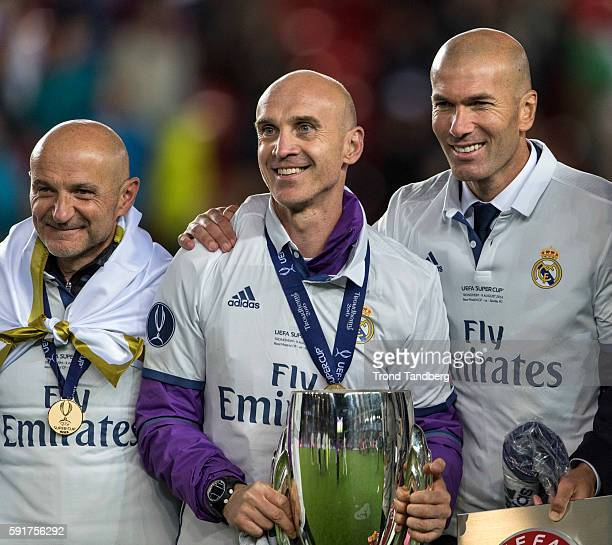 Fitness Coach Antonio Pintus Assistant Coach David Bettani Zinedine Zidane celebrate with the trophy after theUEFA Super Cup match between Real...