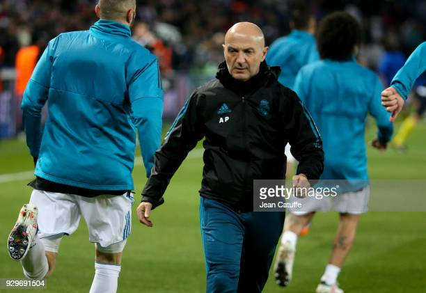 Fitness coach of Real Madrid Antonio Pintus directs the warm up session prior to the UEFA Champions League Round of 16 Second Leg match between Paris...
