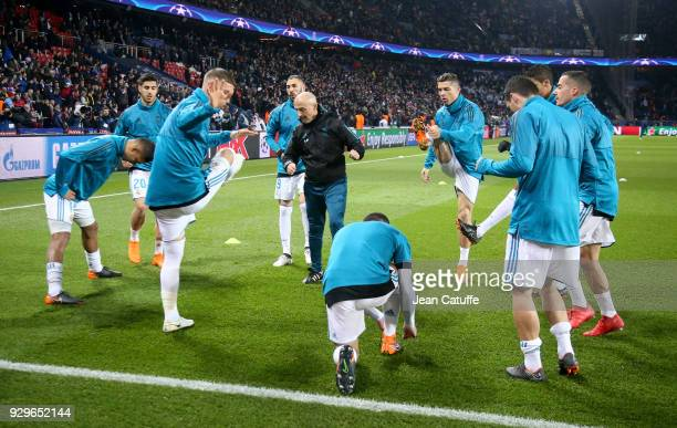 Fitness coach of Real Madrid Antonio Pintus directs the warm up session with Raphael Varane Karim Benzema Cristiano Ronaldo and teammates prior to...