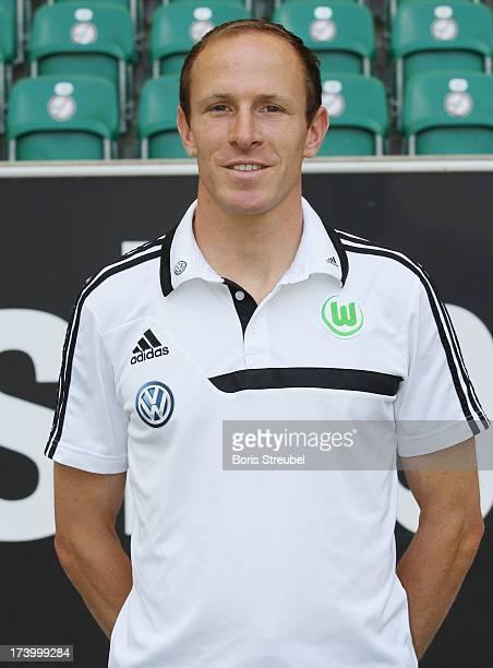 Fitness coach Oliver Mutschler of VfL Wolfsburg poses during the Bundesliga team presentation of VfL Wolfsburg at Volkswagen Arena on July 18 2013 in...
