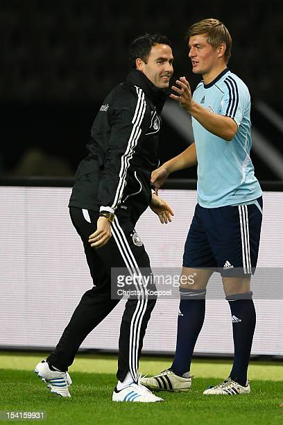 Fitness coach Shad Forsythe watches Toni Kroos of Germany during the training session at Olympiastadion on October 15 2012 in Berlin Germany