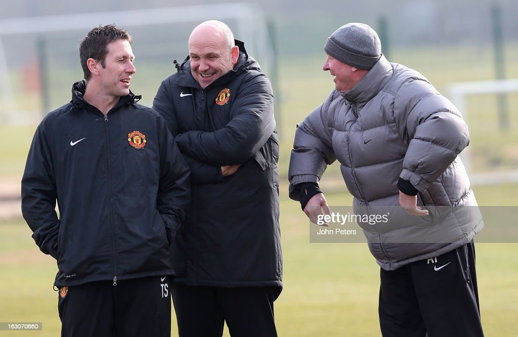 Fitness Coach Tony Strudwick, Assistant Manager Mike Phelan and Manager Sir Alex Ferguson of Manchester United in action during a first team training session, ahead of their UEFA Champions League Round of 16 match against Real Madrid, at Carrington Training Ground on March 4, 2013 in Manchester, England.