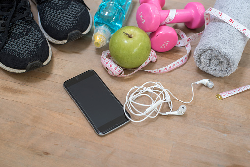Fitness concept background with sneakers, dumbbells, water bottle and towel. Top view with space for your text - gettyimageskorea