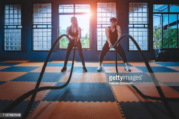 fitness couple at gym. - battle stock pictures, royalty-free photos & images