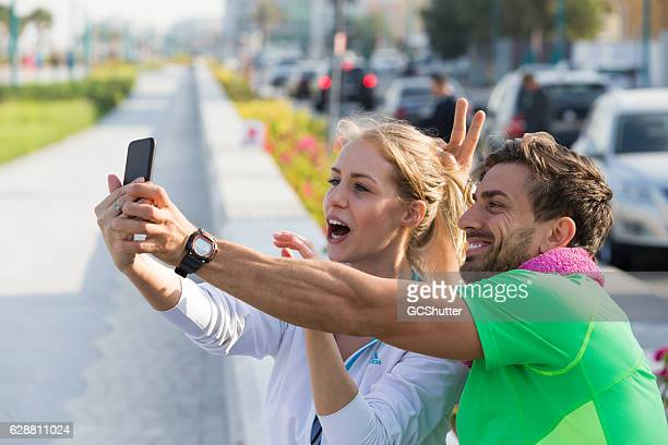 Fitness Couple Taking a Break with a Selfie