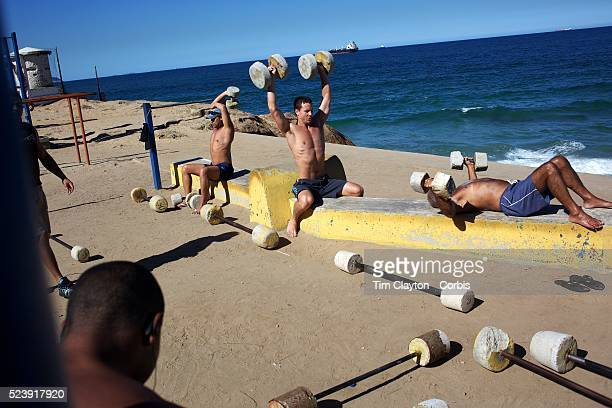 Fitness enthusiasts work out at an outdoor gymnasium overlooking the ocean at Parque do Arpoador between the beaches of Ipanema and Copacabana Rio de...